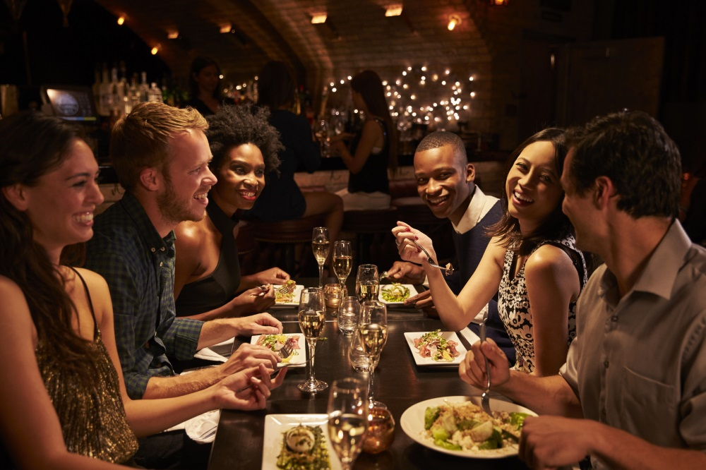 People sitting round table in restaurant