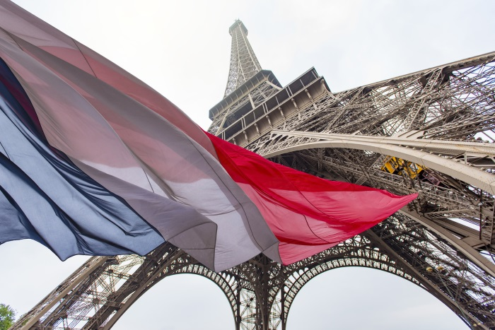 French flag under Eiffel Tower